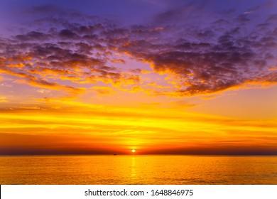 Sunset on the Beach Hawaiian Islands sunrise ocean. Sunset sky cloud at morning background.