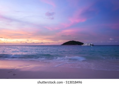 Sunset on the beach with island,boat and beautiful sky background