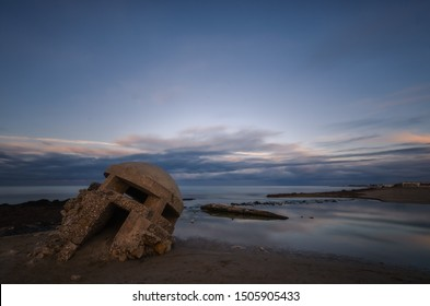 Sunset on the beach, Lecce, Italy. This awesome beachside is characterized by th presence of a First World War outpost.