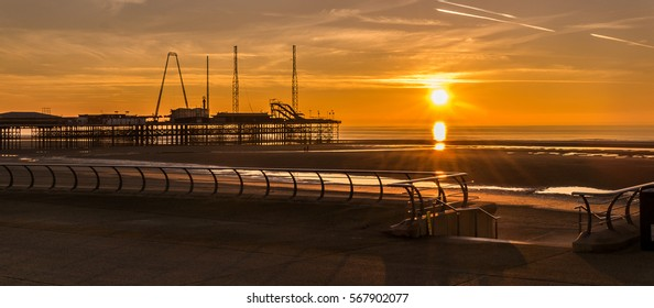 Sunset on a beach at low tide during winter, 16:7 aspect ratio, Sunset On The Beach, Blackpool, England UK