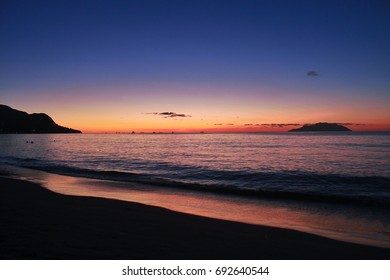 Sunset on the beach of Mahe Island, Seychelles one of the most  tourist attraction in the world.