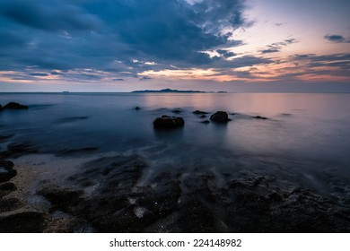 Sunset on beach. Nice view to Ko Lan island from Pratumnak, Pattaya.