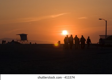 Sunset on beach with people