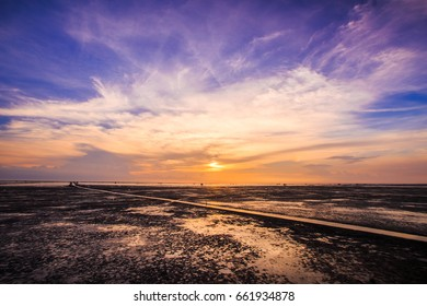 Sunset on the beach and sea with twilight sky when neap tide in Thailand. Inspiration concept.