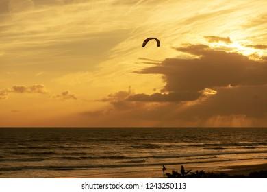 Sunset on the beach Tarifa, alone with kiter