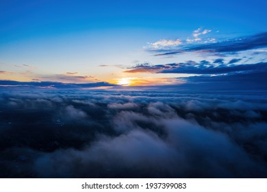 Sunset on blue sky. Blue sky with some clouds. - Shutterstock ID 1937399083