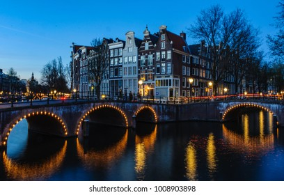 Sunset on the bridges in the UNESCO World Heritage Canals of Amsterdam, Holland