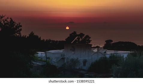 Sunset on Capri island with building oreground