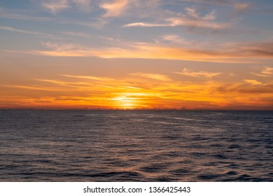 Sunset on the Caribbean Sea. Beautiful yellow and orange sky with clouds