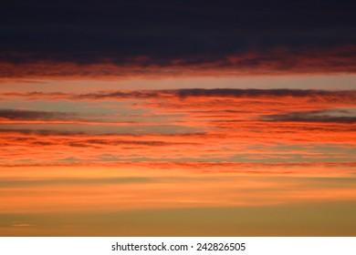 Sunset on a cloudy sky.