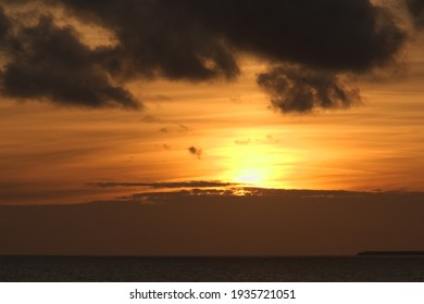 sunset on a cloudy sky at sea