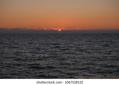 Sunset on the coast. The sun has almost gone beyond the horizon