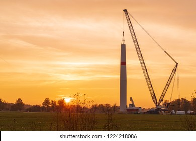 Sunset on the construction site in a wind farm