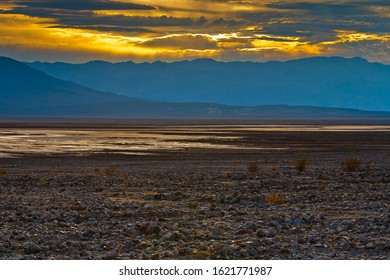 Sunset on a dry salt lake in Death Valley national Park, USA