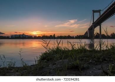 Sunset on the edge of a bridge.