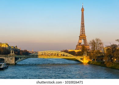 Sunset on Eiffel tower and Pont Rouelle - Paris, France. The Pont Rouelle is only a railway bridge and was constructed for the 1900 World Fair.