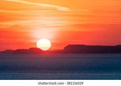 Sunset on expanse of the sea of naples