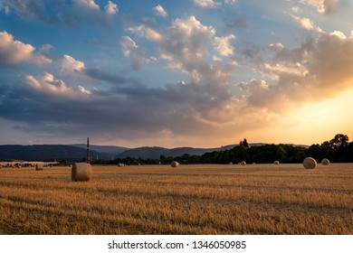 Sunset on a field of Straw after harvest