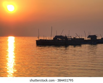 Sunset on floating, fishing village on the lake in Cambodia