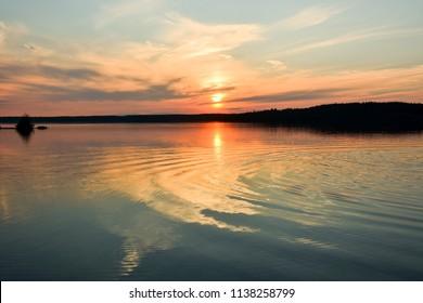 "Sunset on the forest lake ""Krasavitsa"" at Zelenogorsk, Russia"