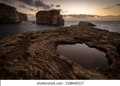 Sunset on Fungus Rock on Malta Gozo. Dwejra Bay at the west coast of the Maltese Island of Gozo.