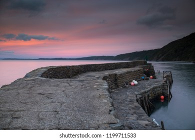 Sunset on the harbour wall at Clovelly in Devon , England