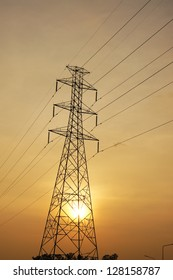 Sunset on high voltage tower