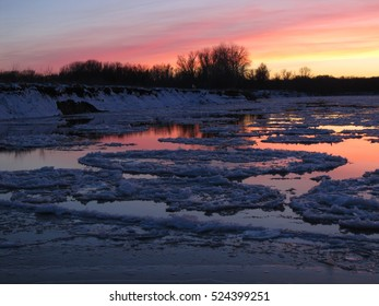Sunset on the Hoper River.  Volgograd region. Amazing colors. Ice on the water. November 2016.