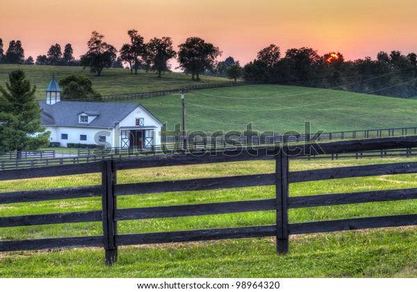 Sunset on a horse farm