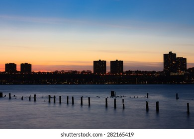 Sunset on the Hudson river with silhouette of New Jersey