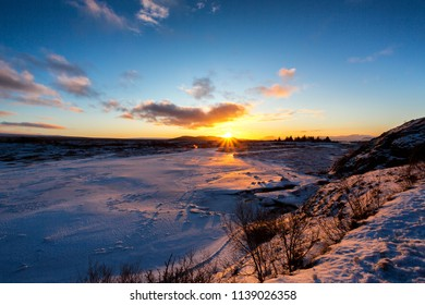 Sunset on icelandeic tundra with snow and ice.