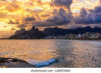 Sunset on Ipanema beach and mountain Dois Irmao (Two Brother) in Rio de Janeiro, Brazil. Ipanema beach is the most famous beach of Rio de Janeiro, Brazil. Seascape of Rio de Janeiro.
