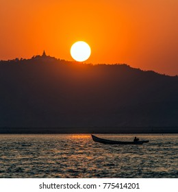 Sunset on the Irrawaddy River (Ayeyarwaddy River) in Myanmar (Burma).  It is the country's largest river and most important commercial waterway.