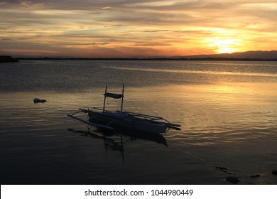 Sunset on the island and boat