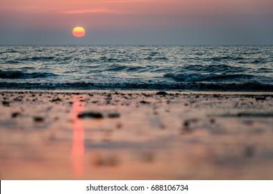 Sunset on Juhu Beach in Mumbai, India.