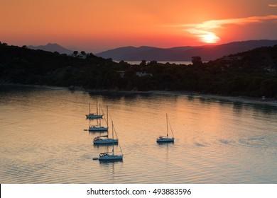 Sunset on Koukounaries beach at Skiathos island in Greece