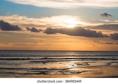 Sunset on Kuta beach in Bali, Indonesia