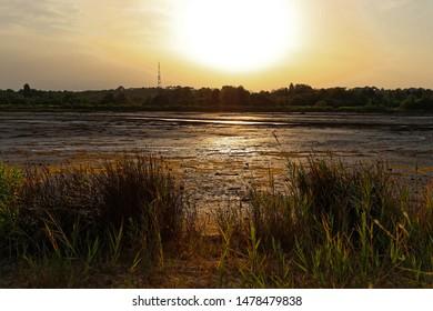 Sunset on a laguna Oyster farmers village la Teste de Buch