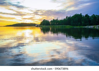 sunset on a lake in Finland