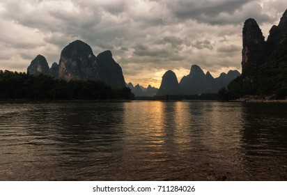 Sunset on Li river in China with its beautiful karst landscape.