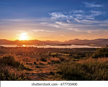 """Sunset on Loch Lomond and Ben Lomond from Duncryne Hill, also known as """"The Dumpling"""", in the village of Gartocharn, just south of Loch Lomond."""