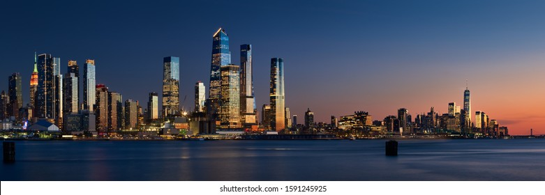 Sunset on Manhattan West with skyscrapers of Hudson Yards and the World Trade Center (Financial District). Cityscape from across the Hudson River, New York City, NY, USA
