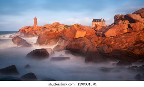 sunset on the mean ruz lighthouse at ploumanac'h