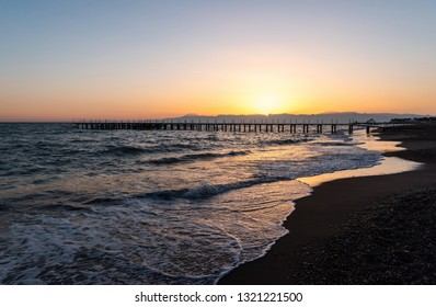 Sunset on Mediterranean beach in Belek resort town of Antalya province in Turkey
