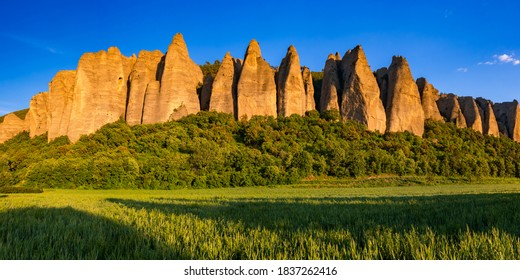 """Sunset on monolith rock formation called """"Les Pénitents"""" near the village of Les Mées. The geologic formation was named for resemblance to monks. Alpes-de-Haute-Provence, PACA Region, France"""