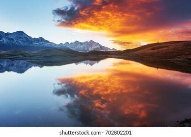 Sunset on mountain lake Koruldi. Upper Svaneti, Georgia Europe. Caucasus mountains.
