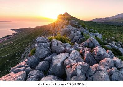 Sunset on the mountain near the sea.Top of rocky mountain