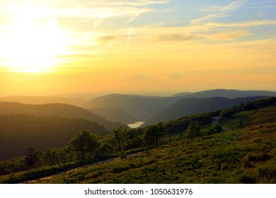 sunset on the mountain in vosges with beautiful colors under the lake