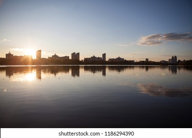 Sunset on the river against the silhouette of the city