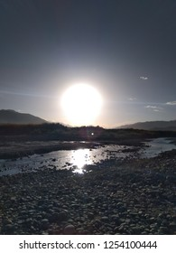 Sunset on a river bank